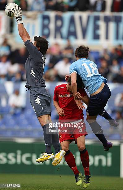 Libor Kozak of SS Lazio competes for the ball with Michael Agazzi and Lorenzo Ariaudo of Cagliari Calcio during the Serie A match between SS Lazio...