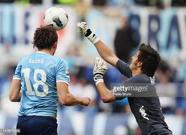 Libor Kozak of SS Lazio competes for the ball with Michael Agazzi of Cagliari Calcio during the Serie A match between SS Lazio and Cagliari Calcio at...
