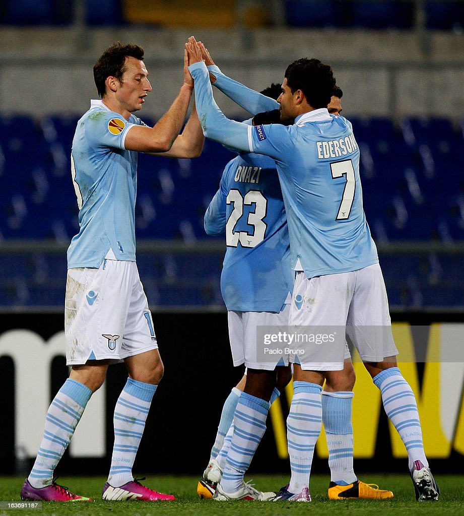 Libor Kozak (L) with his teammates of S.S. Lazio celebrates after scoring the third team's goal during the UEFA Europa League Round of 16 second leg match between S.S. Lazio and VfB Stuttgart at Stadio Olimpico on March 14, 2013 in Rome, Italy.