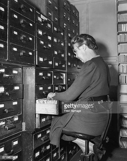 A librarian files index cards at the Keystone Press Agency photographic picture library in London November 1951