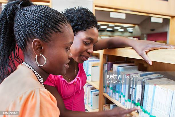 Librarian helping student