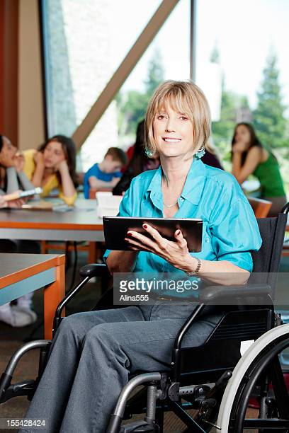 Librarian in a wheelchair working on digital tablet