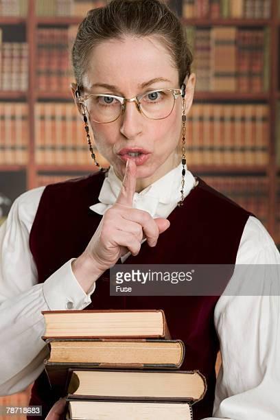 librarian shushing - bibliothekar stock-fotos und bilder