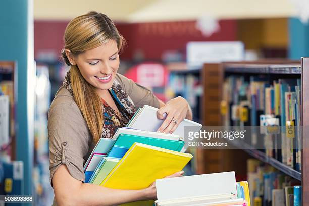 Librarian sorting childrens' books in public or elementary school library