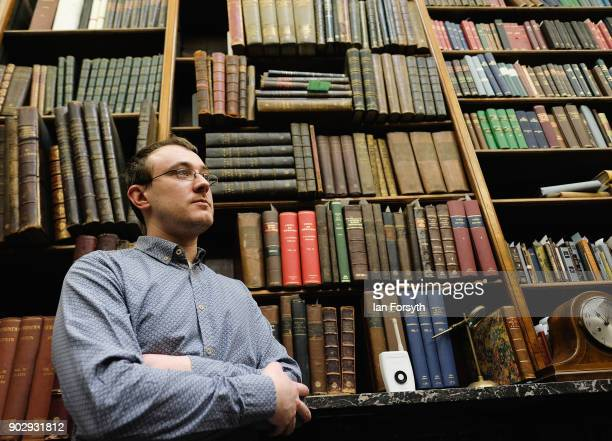 Library Assistant Aidan Thackray stands among the oldest books held inside the Old Librarian's Office at the Leeds Library on January 9 2018 in Leeds...