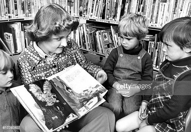 Library Assistant Christine Maley telling a story to Karen Miller Mandy Baker and Gillian Bittlestone at Herrington Library in October 1977
