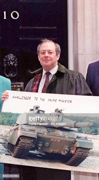 Library filer dated 25/4/1991 of Newcastle Tyne Bridge MP David Clelland outside 10 Downing Street where he was delivering a giant postcard of a...