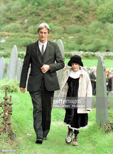 Library filer dated 5/10/96 of Dr Shaun Russell and his daughter Josie walk away from the graveside following the funeral of Lin and Megan Russell...