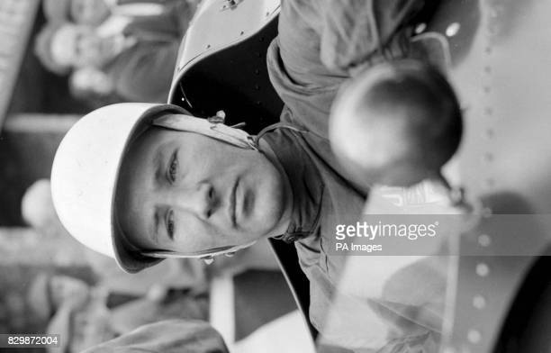 Library filer ref 7723516 dated 15659 of former racing driver Stirling Moss wearing the helmet that saved his life He says had he been wearing a...