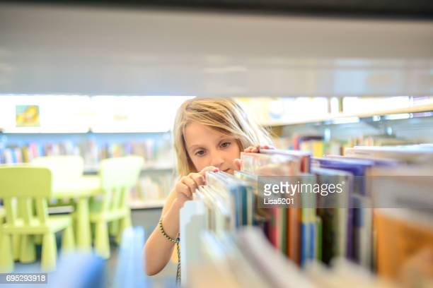 library girl - book store stock photos and pictures