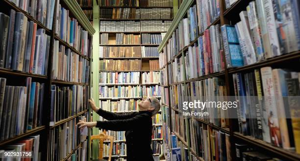 Library member Diane English looks for a book inside the Leeds Library on January 9 2018 in Leeds England This year sees the 250th anniversary of the...