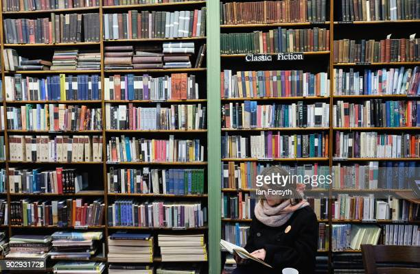 A library member sits and reads inside the Leeds Library on January 9 2018 in Leeds England This year sees the 250th anniversary of the oldest...