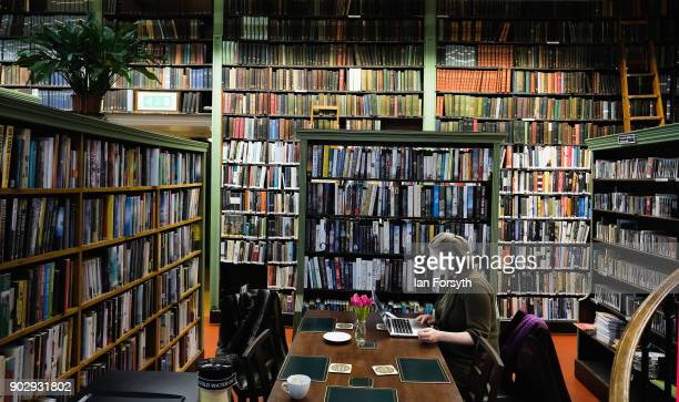 A library member sits and works on her laptop inside the Leeds Library on January 9 2018 in Leeds England This year sees the 250th anniversary of the...