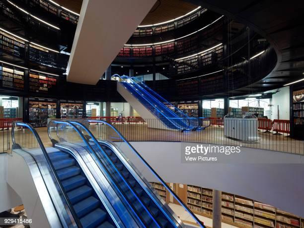 Library of Birmingham, Birmingham, United Kingdom. Architect: Mecanoo Architecten, 2013. Atrium escalators linking multi-storey rotunda.