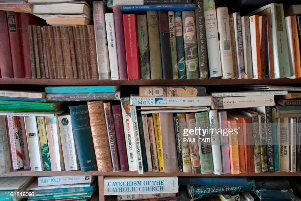 A library of books are seen in the bedroom in the three roomed thatched cottage home of Margaret Gallagher near the village of Belcoo Enniskillen...