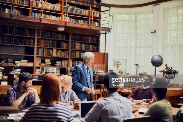 library study - college professor stock photos and pictures
