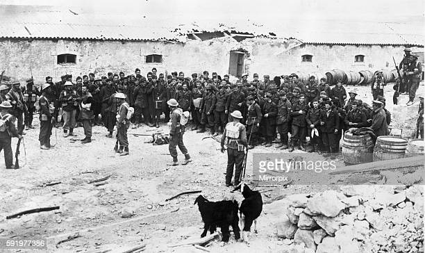 Libya British infantry in possession of an Italian fort after the capture of Derna with their captives lined up in the square March 1st 1941