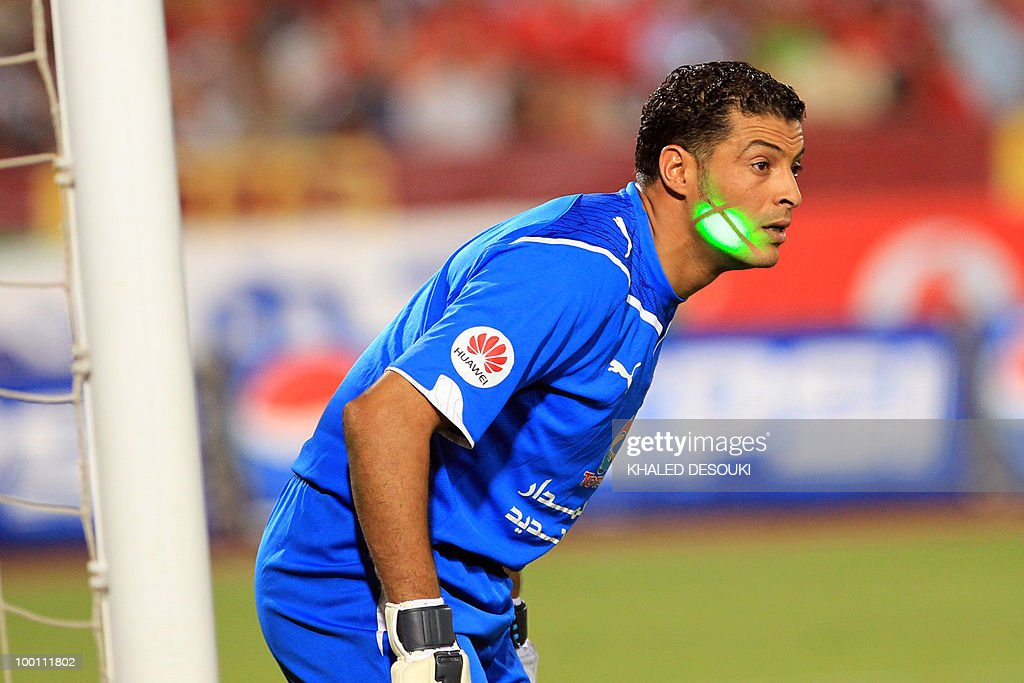 Libyan Al-Ittihad goalkeeper Samir Aboud has a laser pointed at his face by an Egyptian Al-Ahly fan during their African Champions League third round second leg football match in Cairo on May 9, 2010. Al-Ahly won 3-0.