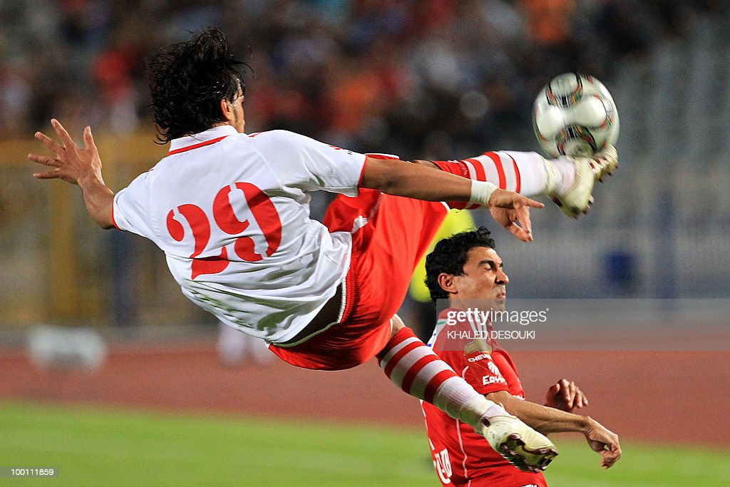 Libyan Al-Ittihad's Abdulaziz Belreesh (L) and Egyptian Al-Ahly's Mohamed Barakat compete for the ball during their African Champions League third round second leg football match in Cairo on May 9, 2010. Al-Ahly won 3-0.
