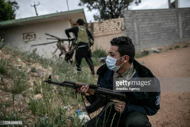 """Libyan Army forces wear masks to protect themselves from coronavirus as they attend """"Operation Peace Storm"""" of the Libyaâs Government of National..."""
