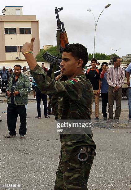 A Libyan army soldier manages incoming traffic at the entrance to Benghazi's AlJalal hospital as wounded victims from clashes between Libyan Special...