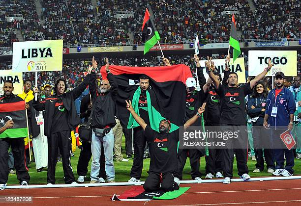 Libyan athletes sing Libya Is Free during the opening of 10th AllAfrica Games in Maputo on September 3 2011 President of Mozambique Armando Guebuza...