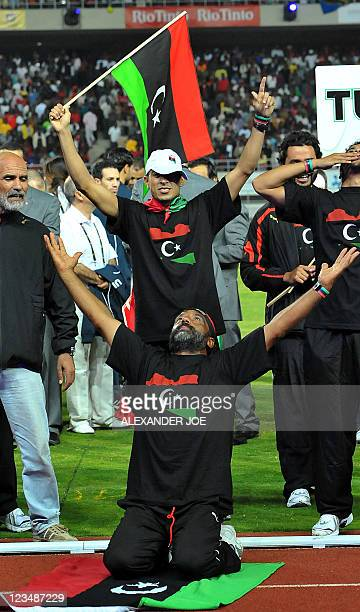 Libyan athletes sing Libya Is Free during the opening of 10th AllAfrica Games in Maputo on September 3 after President of Mozambique Armando Guebuza...