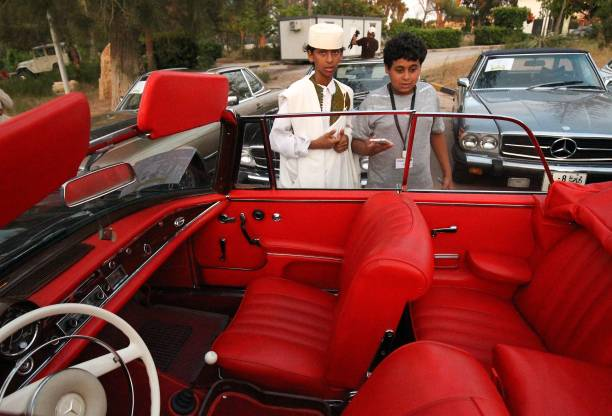 Libyan Boys Look At The Interior Of An Old Mercedes During A Classic Car Show In