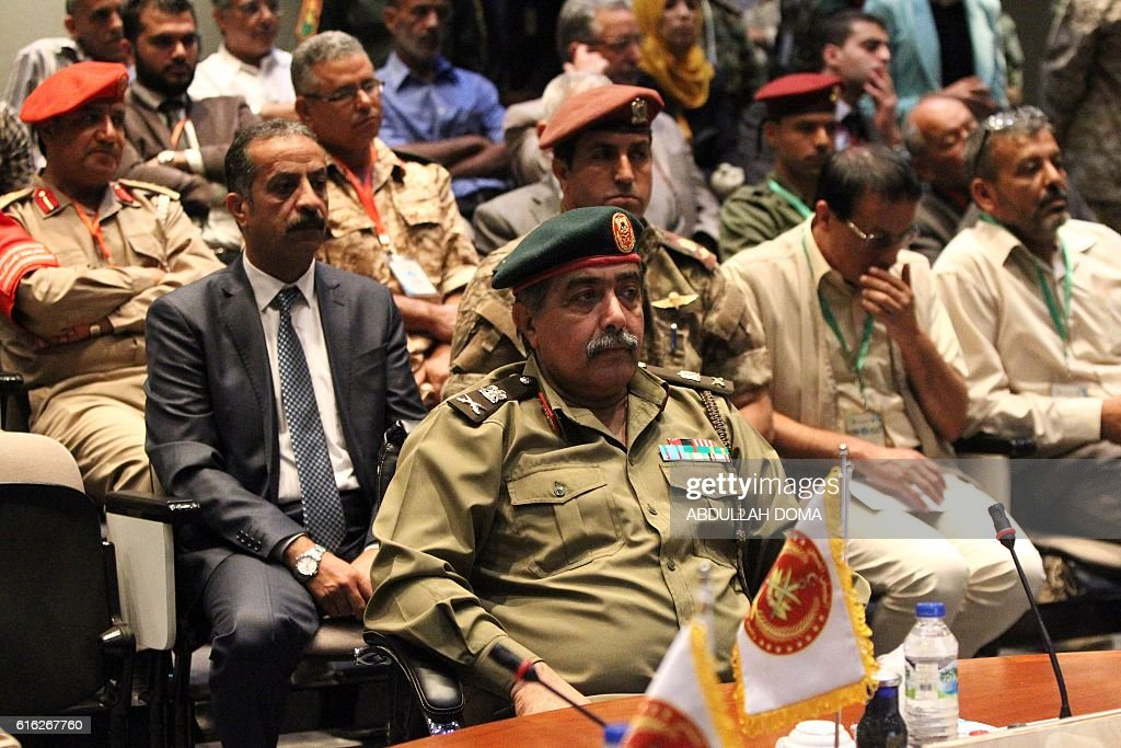 Libyan Chief of General Staff, Major General Abdel Razek Nazawra (C) takes part in a conference titled 'Documenting war crimes' on October 22, 2016 in Libya's second city Benghazi. / AFP / Abdullah DOMA