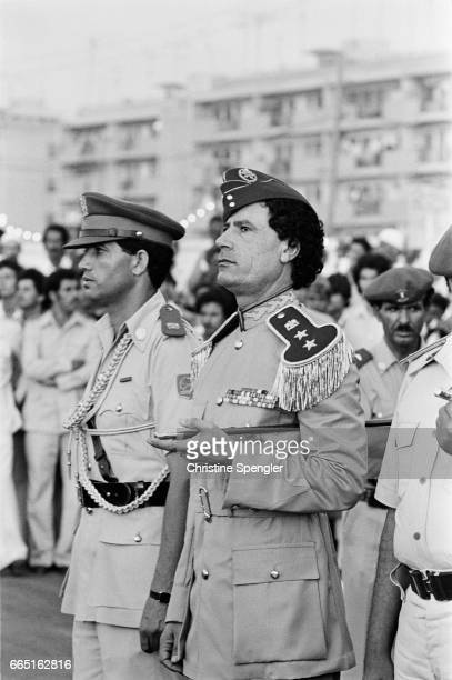 Libyan chief of state Muammar alQaddafi attends a 1981 graduation at the women's military academy in Tripoli The academy opened in 1979 during...