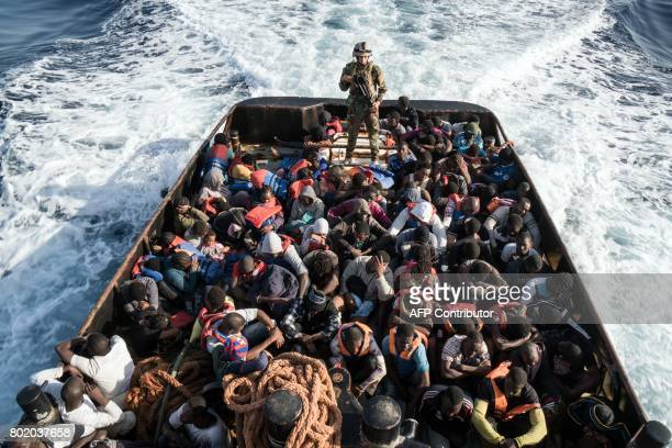 Libyan coast guardsman stands on a boat during the rescue of 147 illegal immigrants attempting to reach Europe off the coastal town of Zawiyah 45...