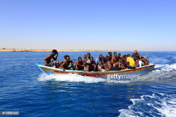 Libyan coastguards help rescue illegal immigrants attempting to reach Europe off the coastal town of Guarabouli 60 kilometres east of the capital on...