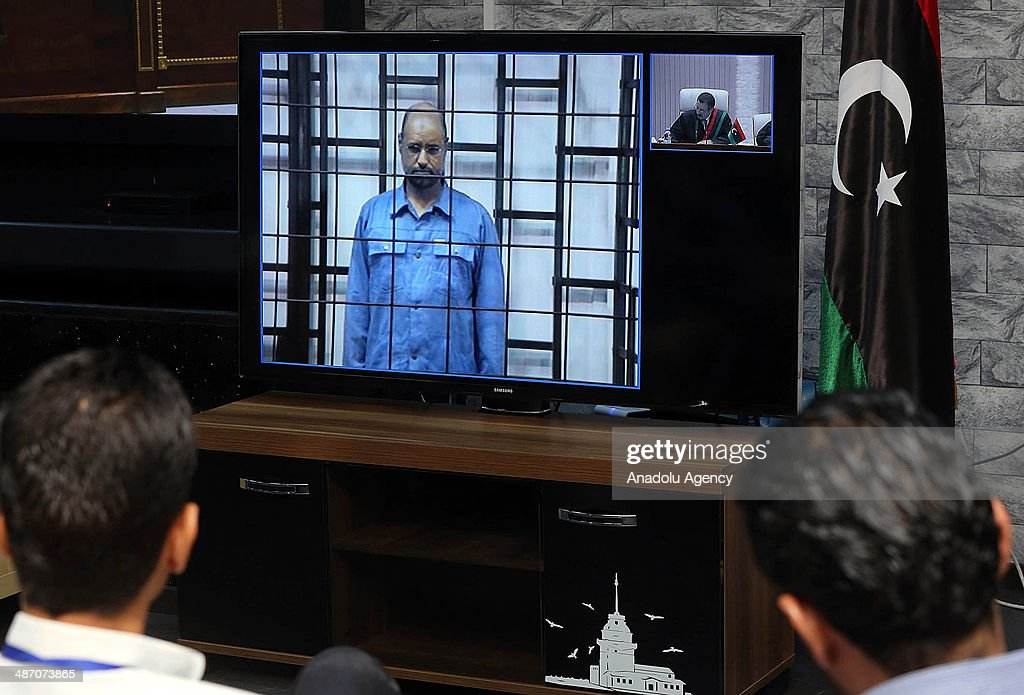 Gaddafi's son Saif, former officials face charges in Tripoli court : News Photo