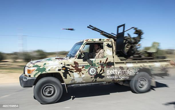 Libyan Dawn Coalition forces patrol with a pickup in Zintan region Libya on March 04 2015 Clashes between Libyan Dawn Coalition and Khalifa Haftar's...