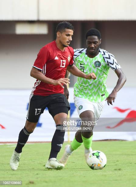 Libyan defender Mohammad Abdulsalam takes possession of the ball from Nigerian Olaolu Aina during the African Cup of Nations qualification match...