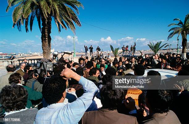 Libyan demonstrators encircle Colonel Muammar Gaddafi the head of state for 19 years during a press conference with the presence of Western...