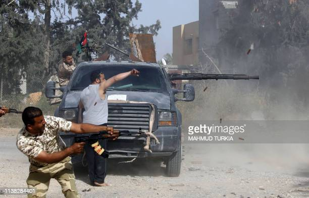 TOPSHOT Libyan fighters loyal to the Government of National Accord fire their guns during clashes with forces loyal to strongman Khalifa Haftar south...