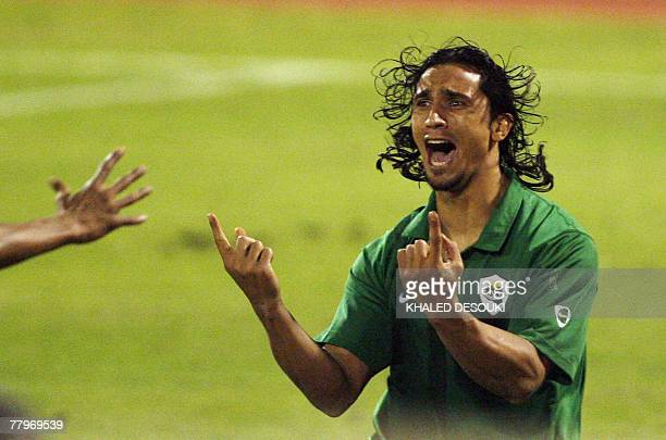 Libyan footballer Amr Dauod celebrates after he scoring the winning goal in the dying minutes of their football match against Saudi Arabia at the...
