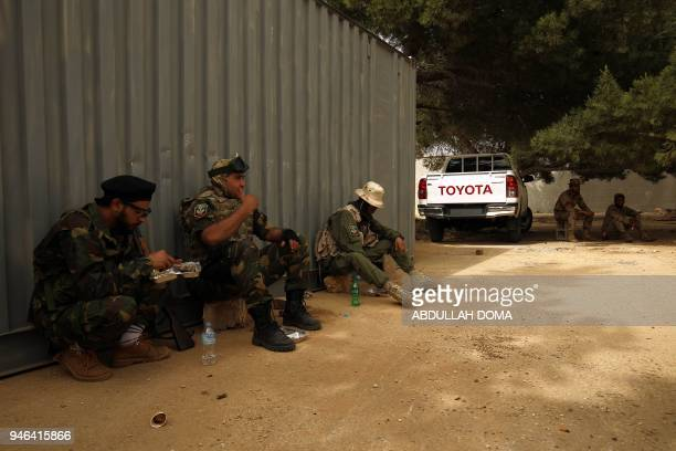 Libyan forces loyal to Libyan strongman Khalifa Haftar gather near the coastal city of Derna on April 14 as they await the start of military...