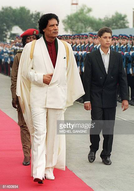 Libyan Head of State Colonel Moamer Kadhafi and his son Seif UlIslam review troops 03 September 1989 upon their arrival to Belgrade prior the...