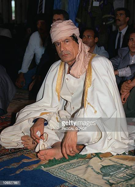 Libyan Head of State Colonel Moamer Kadhafi prays 21 July 1989 in Bamako during sixAfricannation summit to resolve a territorial dispute between...