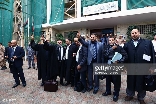 Libyan lawyers celebrate outside the Supreme court on November 6 2014 in the capital Tripoli after the court nullified the country's internationally...
