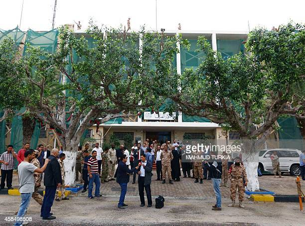 Libyan lawyers journalists and security forces gather outside the Supreme court on November 6 2014 in the capital Tripoli after the court nullified...