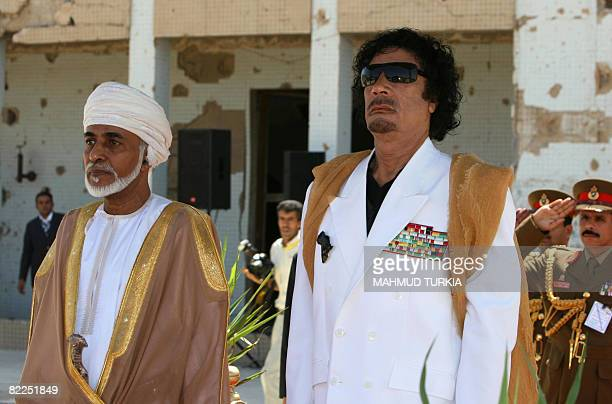 Libyan leader Moamer Kadhafi and Omani Sultan Qaboos bin Said stand for their national anthems upon the latter's arrival at Tripoli on August 11 2008...
