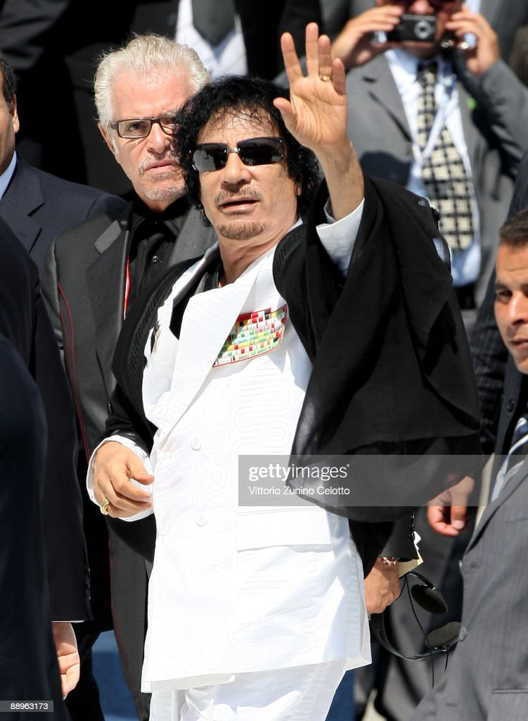 L'AQUILA, ITALY - JULY 10: Libyan leader Moamer Kadhafi arrives for a meeting of the G8 Summit at the Guardia Di Finanza School of Coppito on July 10, 2009 in L'Aquila, Italy. World leaders attending the G8 summit are expected to discuss tackling world hunger and the global reduction of greenhouse gases.