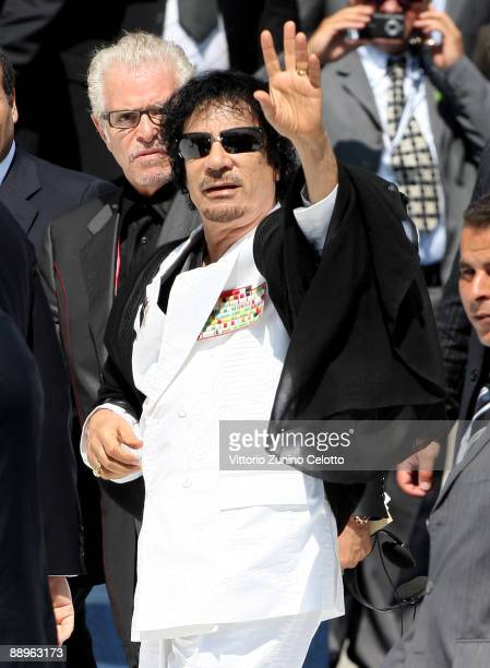 Libyan leader Moamer Kadhafi arrives for a meeting of the G8 Summit at the Guardia Di Finanza School of Coppito on July 10, 2009 in L'Aquila, Italy....