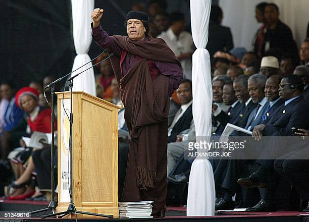 Libyan leader Moamer Kadhafi delivers a speech 09 July 2002 at a stadium in Durban during a ceremony marking the official launch of the African Union...