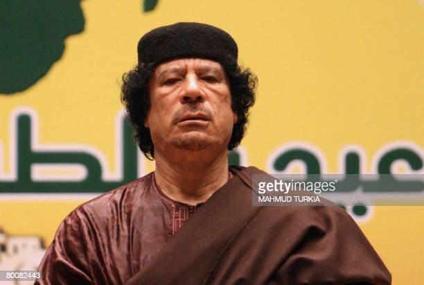 Libyan leader Moamer Kadhafi delivers a speech during a celebration to mark the 31st anniversary of the establishment of Libya's Jamahiriyah or State...