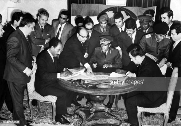 Libyan leader Moamer Kadhafi , Egyptian president Anwar Sadat and Syrian President Hafez el Assad sign the agreement on the creation of the...
