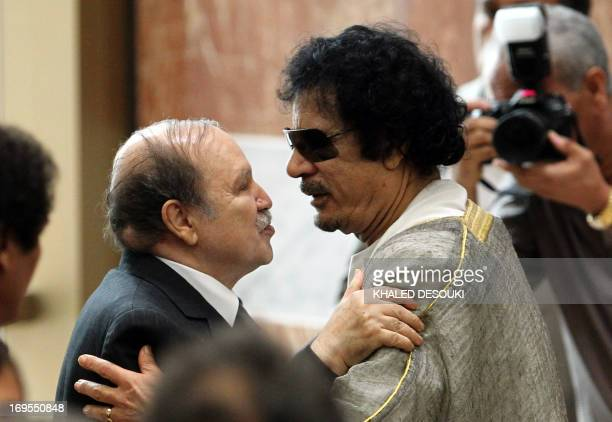 Libyan leader Moamer Kadhafi embraces Algerian President Abdelaziz Bouteflika during the opening session of the Arab League Extraordinary Summit in...